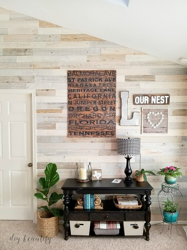 gallery wall on reclaimed wood