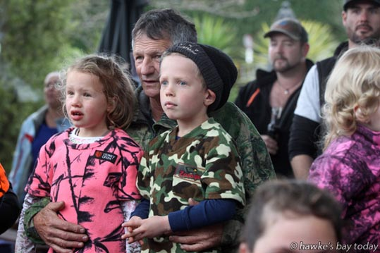 L-R: Jade Fitness, 5, Pete Julian (Poppa), Zac Fitness, 7, Haumoana, all wearing camo clothing - Tiki/Onga Children's Hunting Competition, organised by the Tiko/Onga Hunting and Fishing Club, prizegiving at Tikokino Country Hotel, aka Sawyers Arms Hotel, Tikokino, Central Hawke's Bay, one of the events in the Central Hawke's Bay Spring Fling. photograph