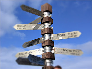 Signpost to various worldwide capitals