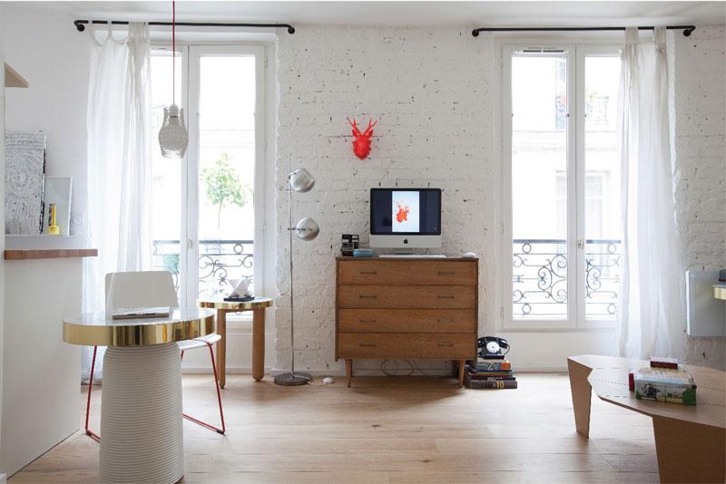 mattoni lasciati a vista dipinti di bianco