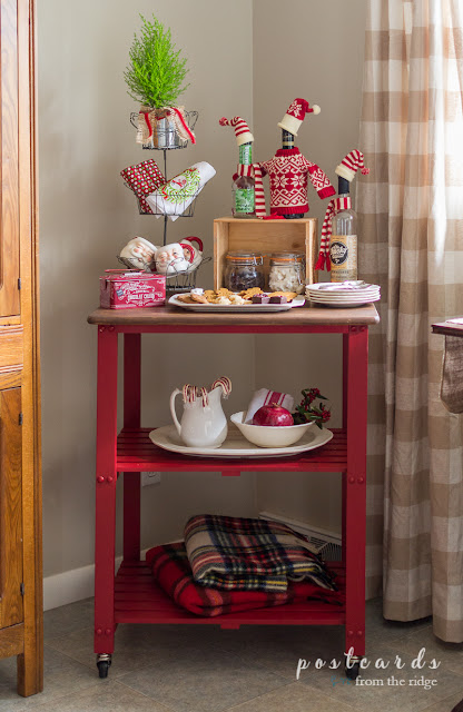 red kitchen cart used for hot cocoa items