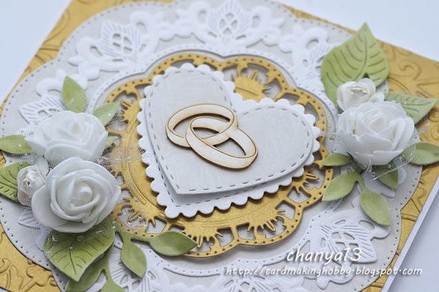 detale kartki -kwiaty, obrączki, elementy z wykrojnika