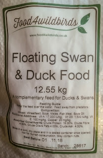 Photo of floating swan and duck food