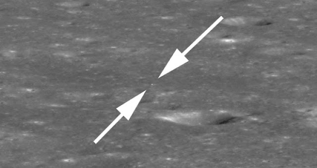 Area around lander enlarged by a factor of two relative to the native pixel scale, bright speck between two arrows is the lander. The large crater in the center (just right and below arrows) is about 440 meters (1,440 feet) across. LROC NAC M1303521387LR Credits: NASA/GSFC/Arizona State University