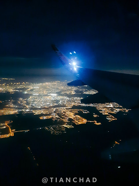 View of the city night view from airplane window