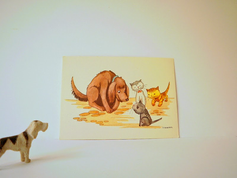 Vintage illustrated post card of a group of cute dogs