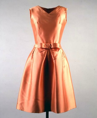 Apricot colored belted and sleeveless silk dress designed by Oleg Cassini and worn by Mrs. Kennedy on boat ride in India