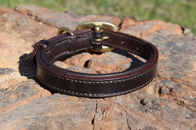 Padded collar with solid brass oval buckle made on measure in dark havana leather and hand stitched suitable for a small size puppy