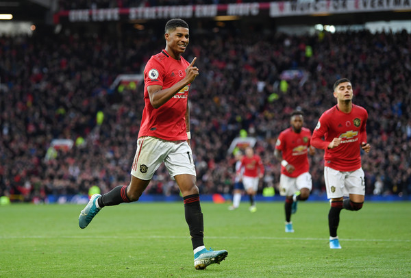 Marcus Rashford of Manchester United celebrates after scoring his team's third goal during the Premier League match between Manchester United and Brighton & Hove Albion at Old Trafford on November 10, 2019 in Manchester, United Kingdom