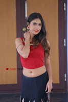 Telugu Actress Nishi Ganda Stills in Red Blouse and Black Skirt at Tik Tak Telugu Movie Audio Launch .COM 0325.JPG