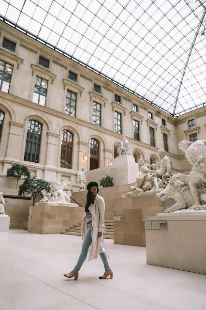Alicia Mara inside of the Louvre Museum in Paris