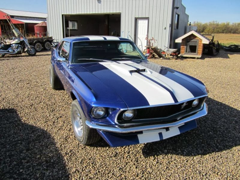 Ford Mustang Photos and Reviews: Ford Mustang Photos Past ...1969 Mustang Coupe Blue