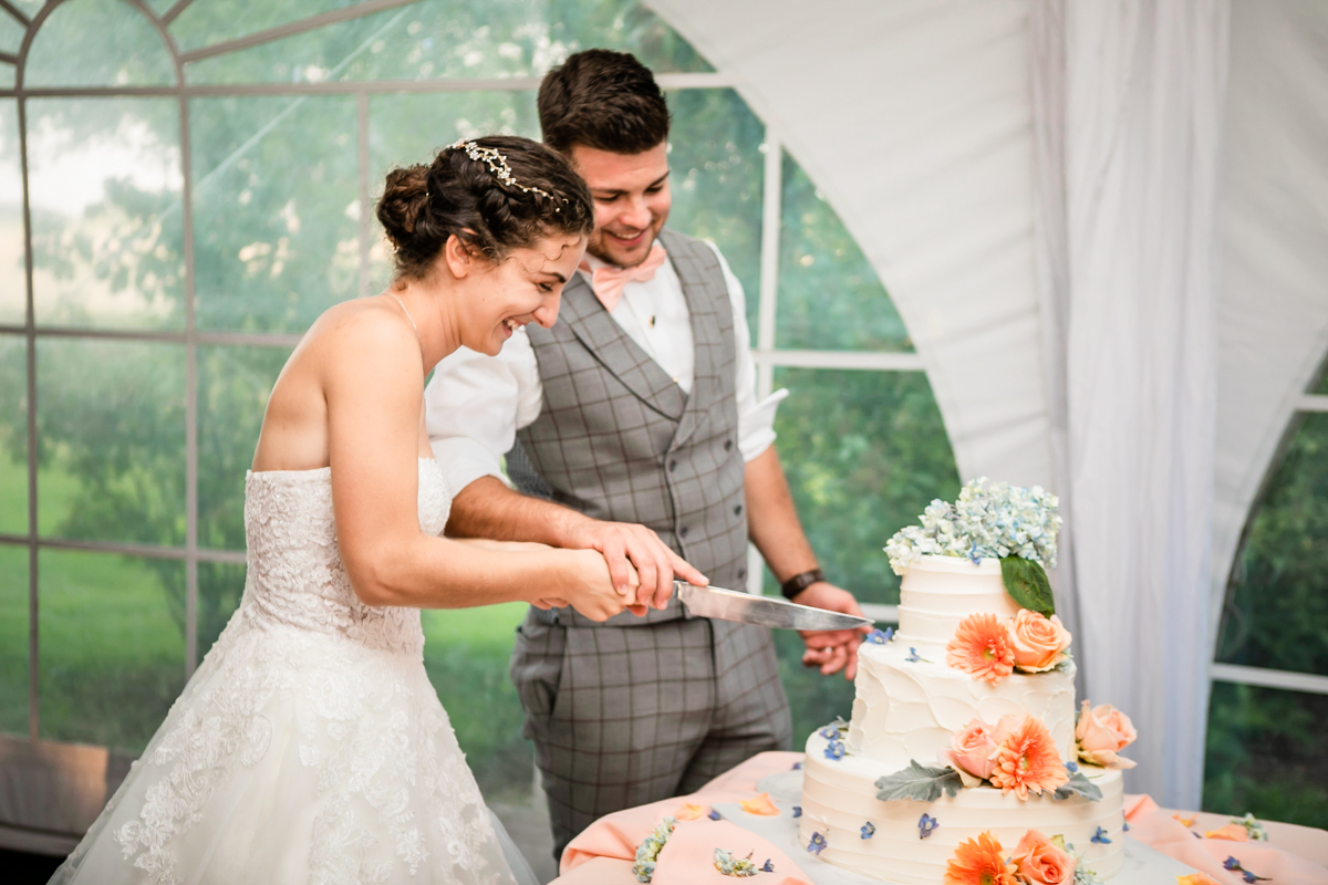 Couple cutting a well decorated cake on their big day.