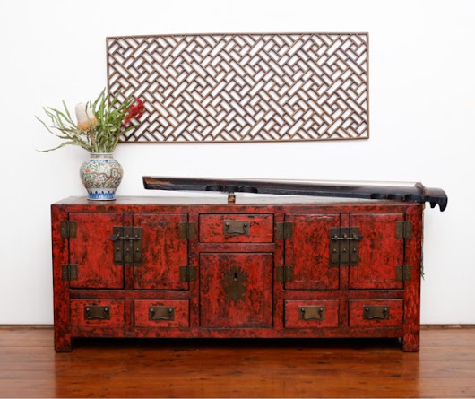 Small red sideboard made from recycled elm, perfect for your new LED TV.