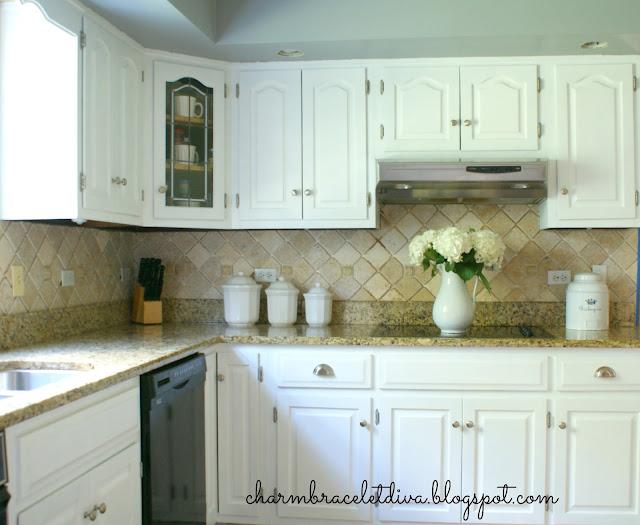 white hydrangeas ironstone pitcher kitchen countertop glass stove top