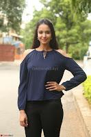 Poojita Super Cute Smile in Blue Top black Trousers at Darsakudu press meet ~ Celebrities Galleries 040.JPG