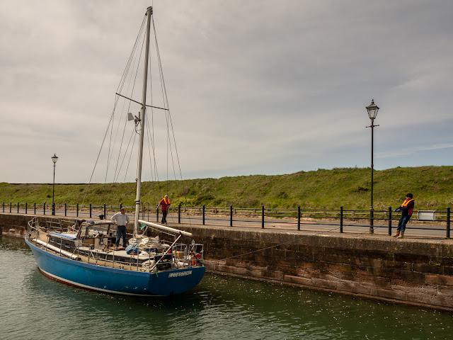 Photo of Lodestone is towed along the marina wall