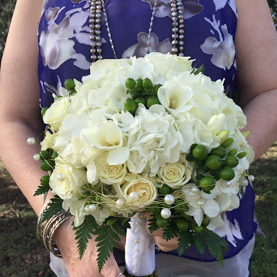 White bridal clutch bouquet with pearls by Stein Your Florist Co.