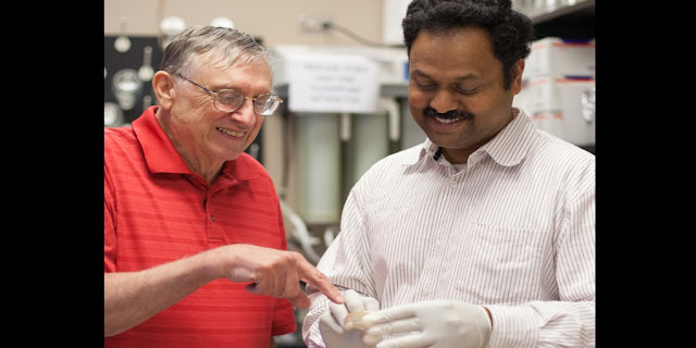 In the lab of George Fox, left, Madhan Tirumalai, right, is helping unravel the mysteries of space microbiology. Credit: NASA