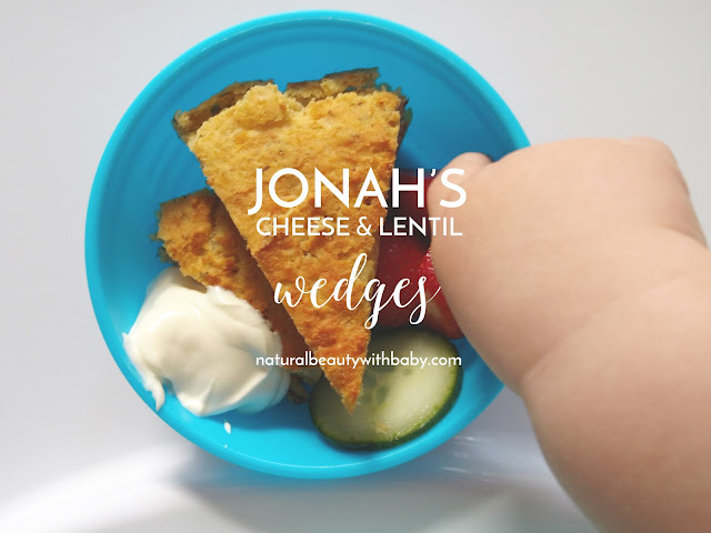 Jonah tucking into cheese and lentil wedges