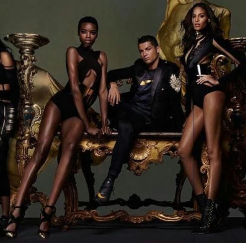 a Cristiano Ronaldo poses with French designer Olivier Rousteing and Nike in new photos