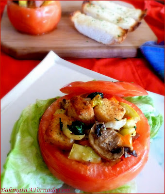 Bountiful Stuffed Tomatoes: filled with garden vegetables, parmesan and croutons, bursting with fresh flavor for a healthy lunch or side dish. | Recipe developed by www.BakingInATornado.com | #recipe #vegetables