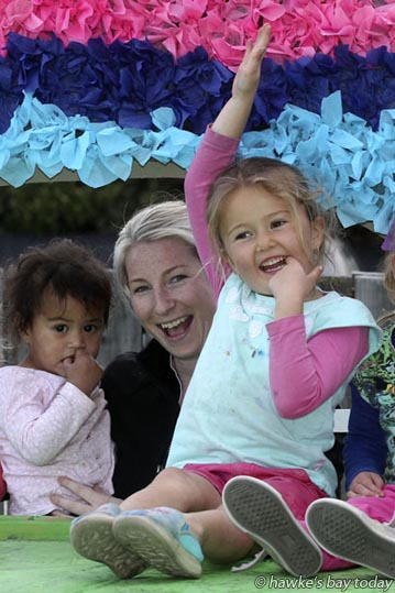L-R: Alatina, Abbey Kelsen, team leader (babies), Addison, Rascals Childcare, Hastings, with their float for this Saturday's Blossom Parade. photograph