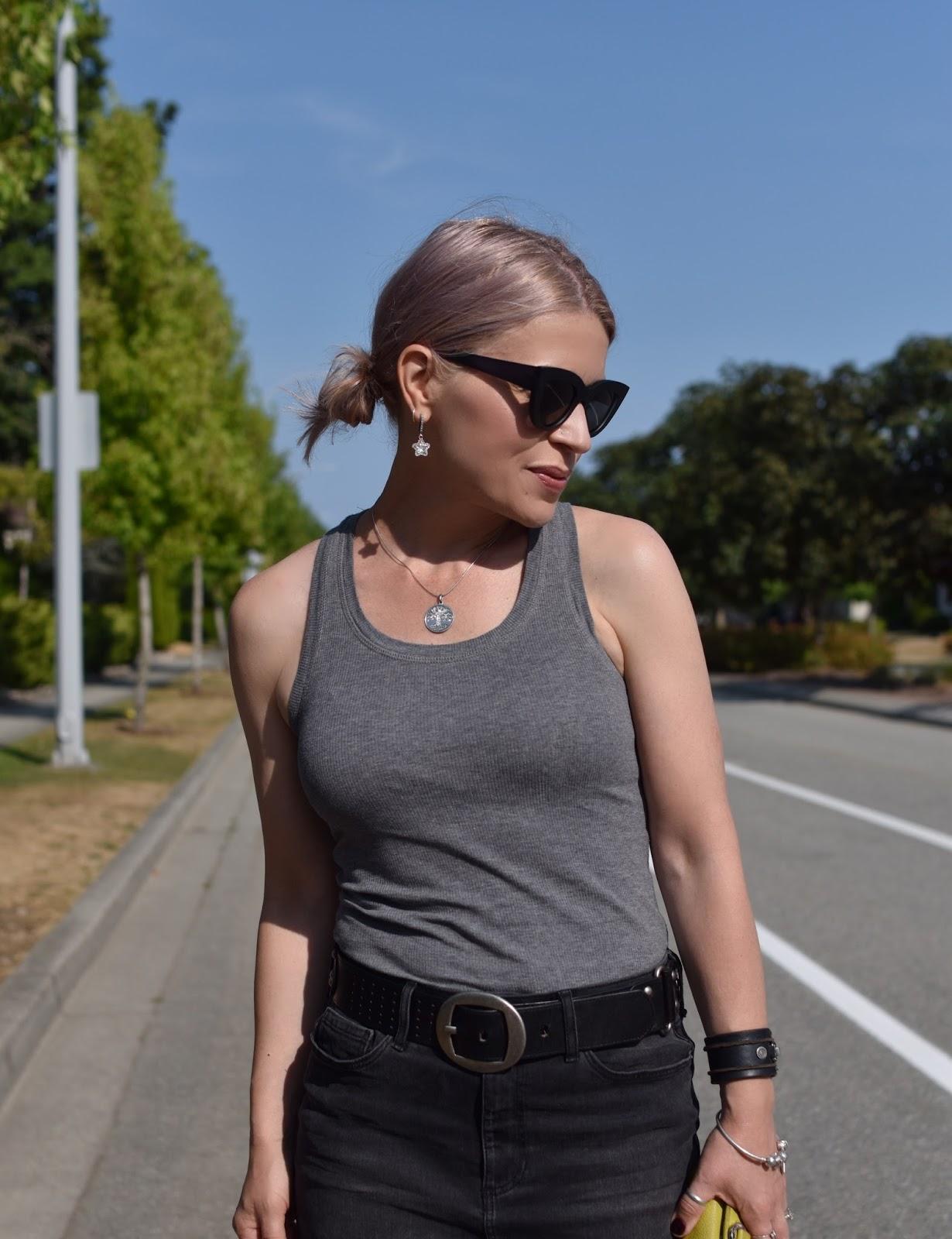 Monika Faulkner outfit inspiration - grey tank top, black denim pencil skirt, cat-eye sunglasses