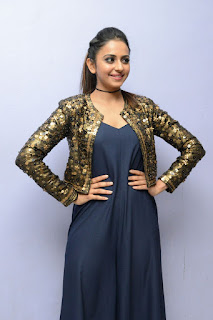 Rakul PReet Singh beautiful dazzling GoldenJacket and Black Gown at Dhruva theatrical trailer launch