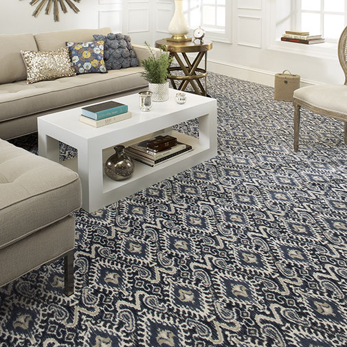 Blue patterned carpet adds a lot of design flair to this room.