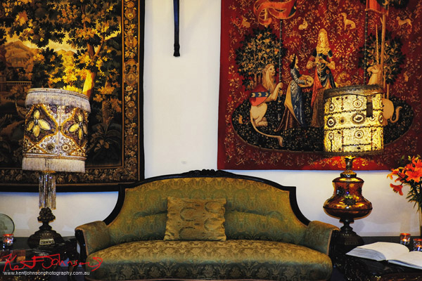 Hotel reception, couch, lamps and tapestries. Boutique Hotel photography in Prague by Kent Johnson.