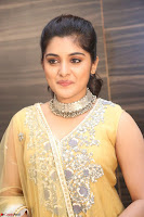 Nivetha Thamos in bright yellow dress at Ninnu Kori pre release function ~  Exclusive (66).JPG