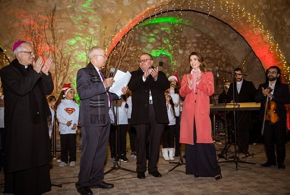 Queen Rania wore wool cashmere coat in coral pink. Christmas tree lighting ceremony at Qanater Ampitheatre in Fuheis