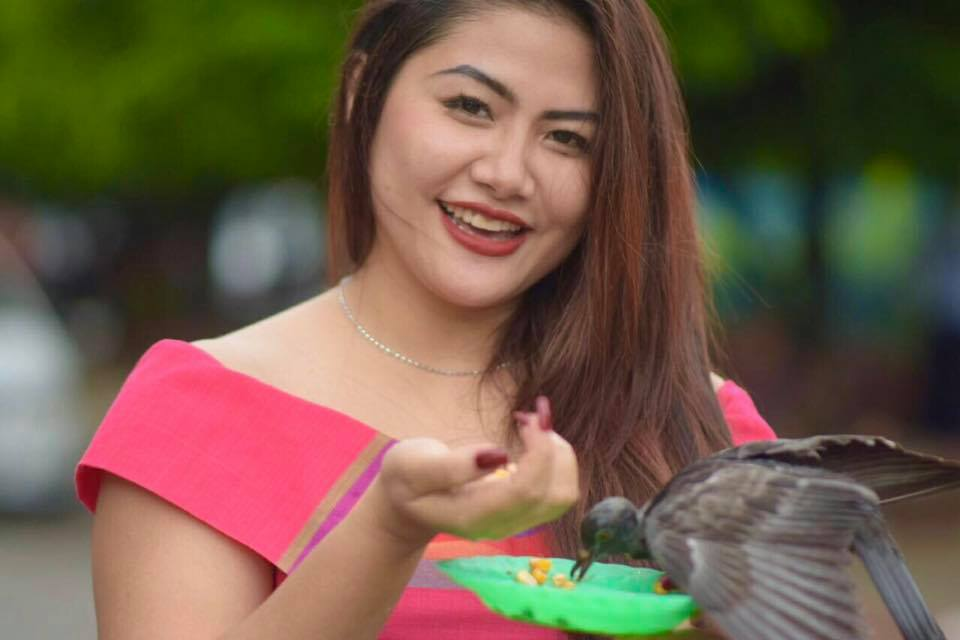 Celebrity May Pachi shares her snaps feeding pigeons in Yangon