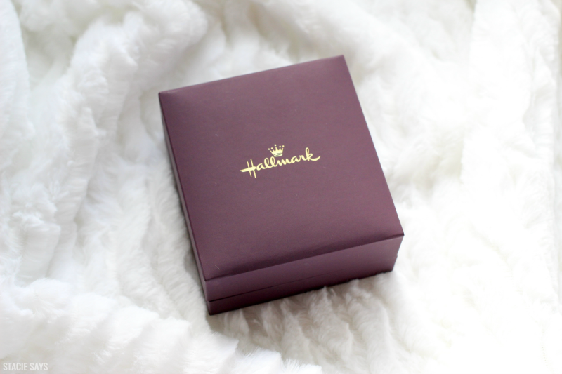 a burgundy Hallmark jewelry box on a white blanket