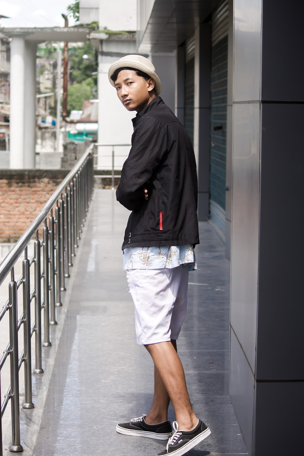TheQuirkyMinimal by Kangkan Rabha for Farfetch Apple Music partnership wearing Vintage Prada jacket, Old Navy Printed shirt, Thrifted DIY pants, Black Vans via Jabong, Levis Hat