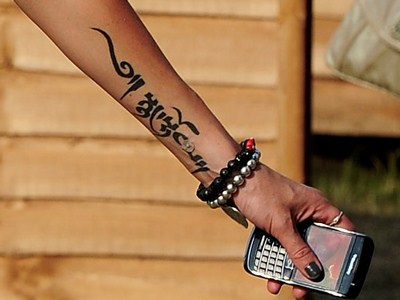 880af910d tattoo on the Girls Aloud star's inner arm.