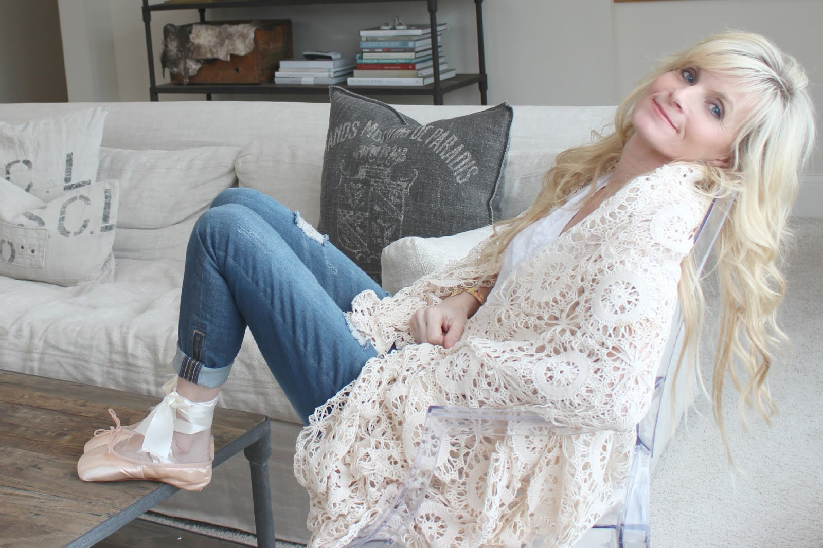 Image of woman relaxing in stylish Belgian style living room - blogger Michele of Hello Lovely Studio