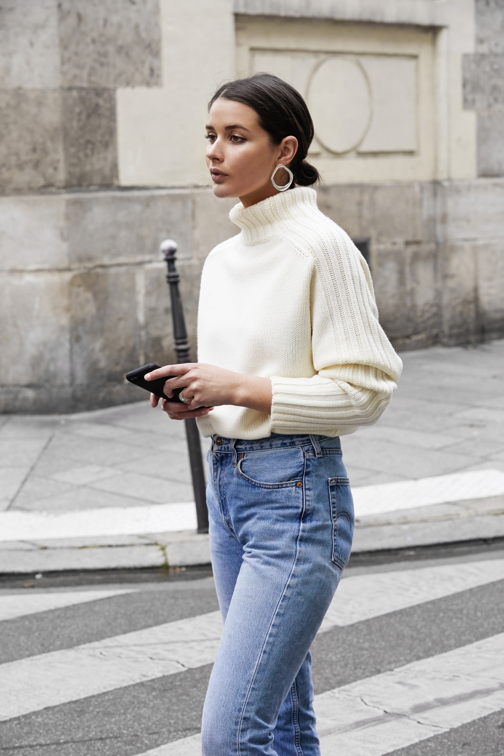This Stylish Denim Outfit Is a No-Brainer for Winter — Harper & Harley's Sara Crampton in hoop earrings, turtleneck sweater, and Levi's jeans