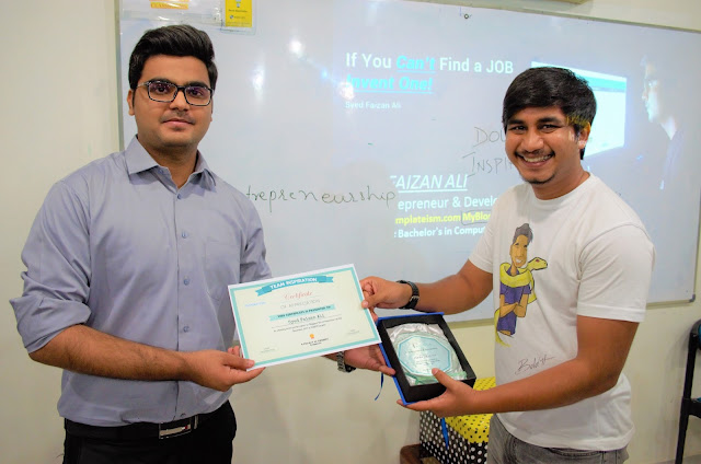 Syed Faizan Ali Receiving Award for Conducting the workshop at SZABIST
