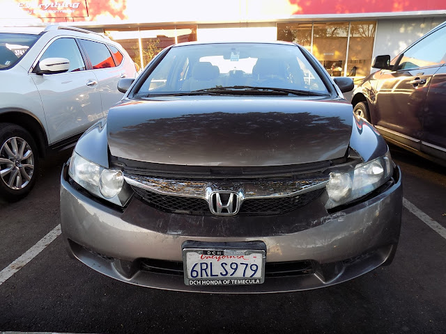 2011 Honda Civic with dented hood & bumper before repairs at Almost Everything Auto Body.