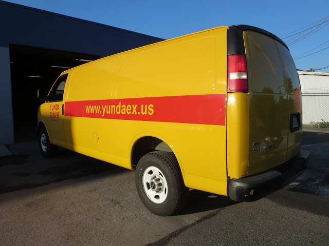 Used work truck with previous company's colors and graphics
