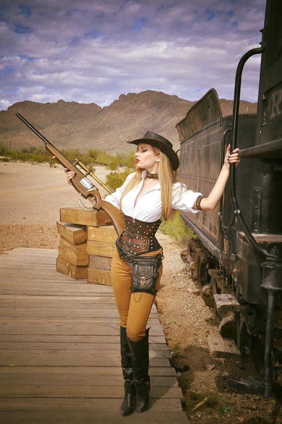 Woman wearing western cowboy/cowgirl clothing in the style of the wild wild west steampunk genre (aka weird west sci fi). Corset, hat, boots, pants, blouse, gun.