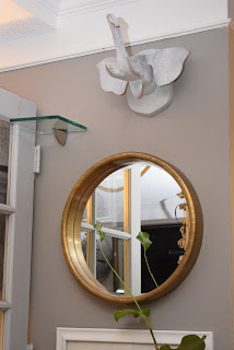 Wall Art; hanging mirrors & wall art in nook area; spacesmadeperfect.com