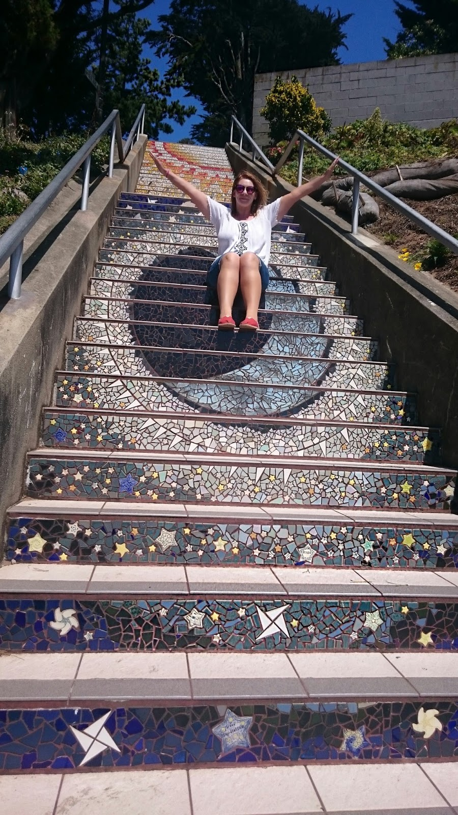 Me posing on the mosaic Moraga Steps San Francisco