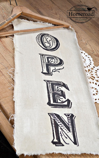 Length of painted canvas with OPEN painted on it