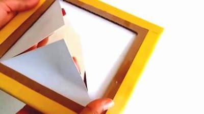 Membuat X atau silang pada bagian tengah bingkai