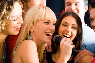 Photo of three women singing at a party