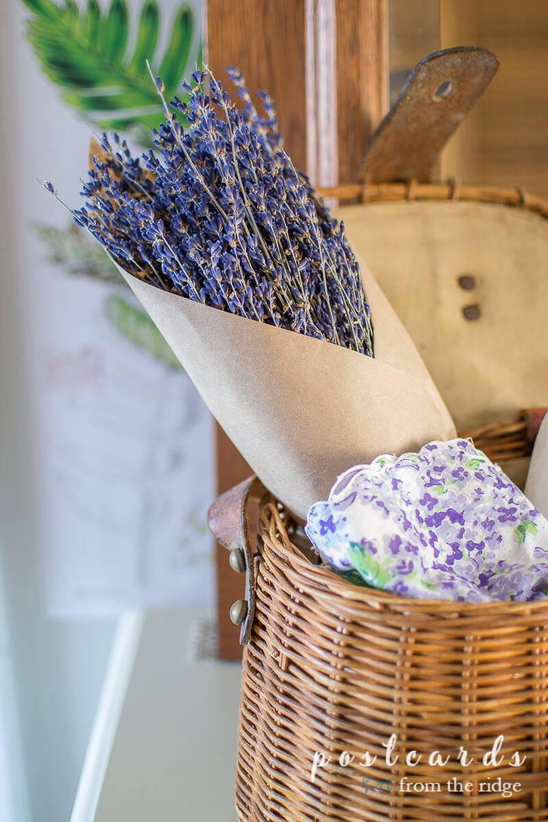 dried lavender and vintage linens in fishing creel basket
