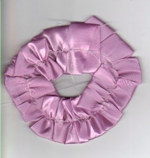 Purple 3/4 inch ribbon removed from cardboard wrapper